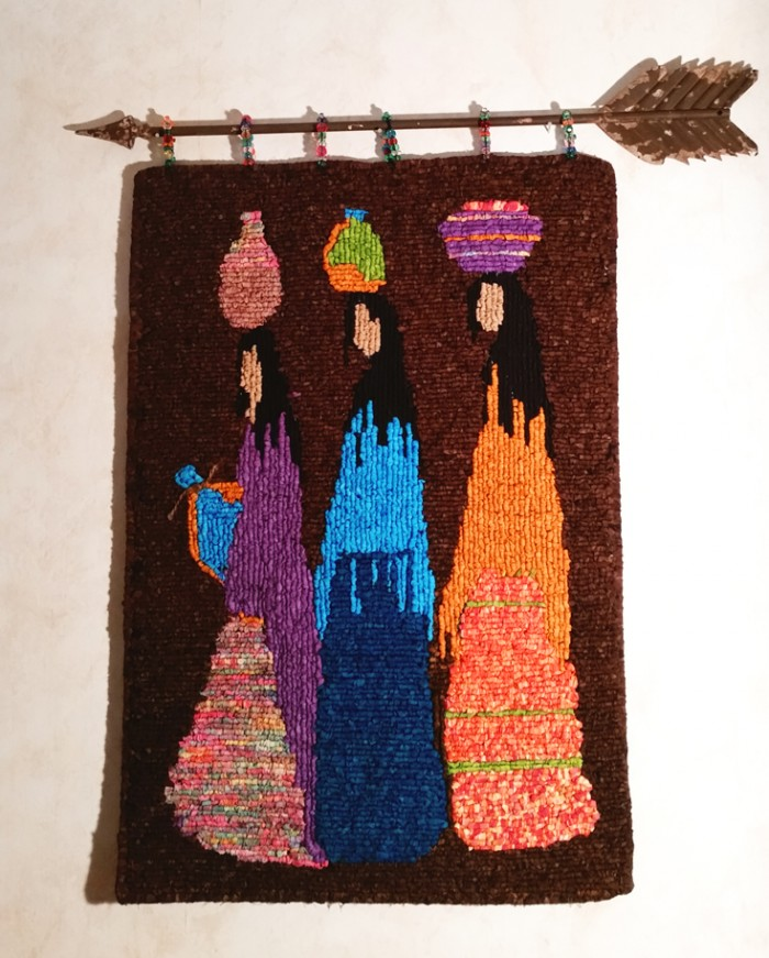 The Water Carriers - locker hooked wall hanging by Debra Cottner
